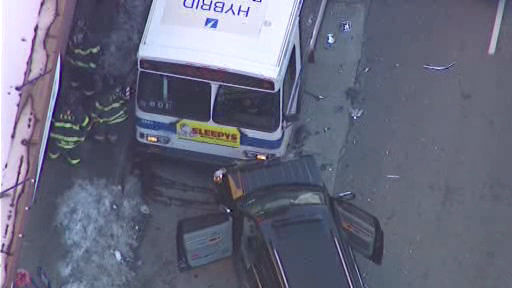 A New York City bus and 2 vehicles collided in Harlem Wednesday morning, injuring at least 11 people.