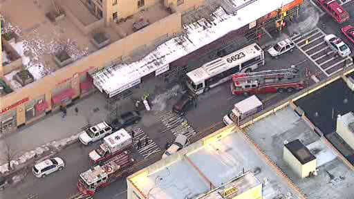 "<div class=""meta image-caption""><div class=""origin-logo origin-image ""><span></span></div><span class=""caption-text"">A New York City bus and 2 vehicles collided in Harlem Wednesday morning, injuring at least 11 people. </span></div>"