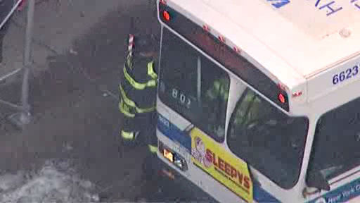 A New York City bus and two vehicles collided in Harlem Wednesday morning, injuring at least seven people.