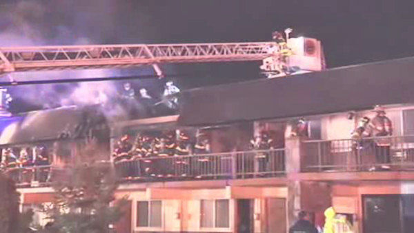 A fire broke out Friday night at a Hauppauge motel that was housing a group of people displaced by Superstorm Sandy.