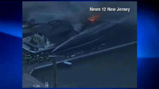 Smoke could be seen over the Hudson River Monday morning, as some boats caught fire in their slips in Weehawken, NJ.