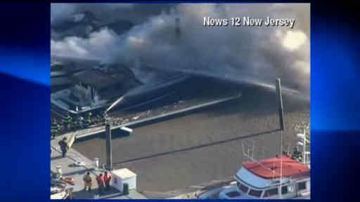 "<div class=""meta ""><span class=""caption-text "">Smoke could be seen over the Hudson River Monday morning, as some boats caught fire in their slips in Weehawken, NJ.</span></div>"