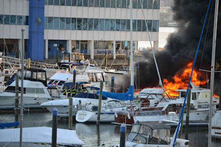 Smoke could be seen over the Hudson River Monday morning, as some boats caught fire in their slips in Weehawken, NJ. <span class=meta>(Beth Gordon)</span>