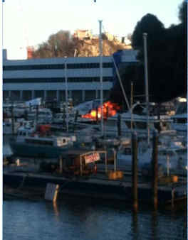 Smoke could be seen over the Hudson River Monday morning, as some boats caught fire in their slips in Weehawken, NJ. <span class=meta>(Martin Fern)</span>