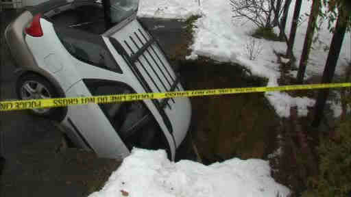 Rescue crews rescued a Long Island woman after her car was swallowed by a former cesspool that opened up the ground.