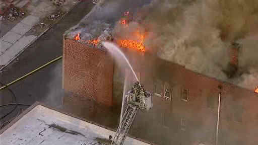 "<div class=""meta image-caption""><div class=""origin-logo origin-image ""><span></span></div><span class=""caption-text"">A building in Paterson caught on fire late Thursday afternoon.</span></div>"