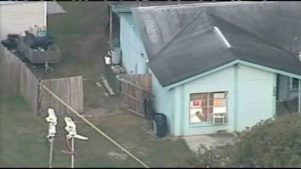 Rescue crews searched for a Florida man Friday after a large sinkhole opened under the bedroom of a house near Tampa.