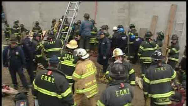 A worker was trapped after a trench collapsed at a construction site in East Harlem.