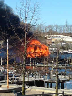 A boat house and pier caught fire at a marina in Port Jefferson, New York. <span class=meta>(Joyce E. Phiblin-Collier)</span>