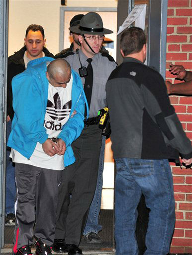Pennsylvania State Police, along with New York City police officers, transport Julio Acevedo, 44, from the State Police Barracks in Bethlehem, Pa, Wednesday night, March 6, 2013, to the Lehigh County Prison. Acevedo was wanted by the New York City Police in connection with leaving the scene of an accident resulting in the death of expectant parents Nachman and Raizy Glauber. Their premature child also died as a result of the accident. &#40;AP Photo&#47;Tim Wynkoop&#41; <span class=meta>(AP Photo&#47; Timothy E. Wynkoop)</span>