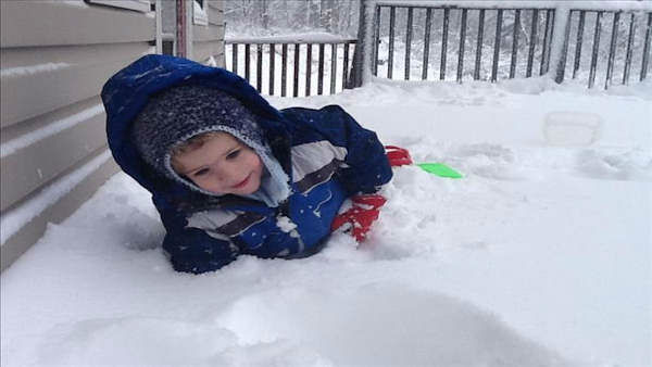 """My Grandson Andrew Bussard on his back deck. We have 16inches and counting here in Greenwood Lake, Ny."""