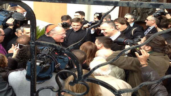 A crowd of media and parishioners greet Cardinal Dolan this morning in Rome. -@JoeTorresABC7