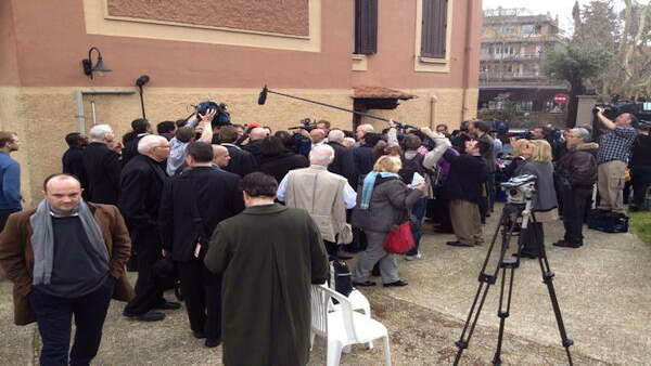 He's in there somewhere! A swarm of media crowd Cardinal Dolan today in Rome. -@JoeTorresABC7