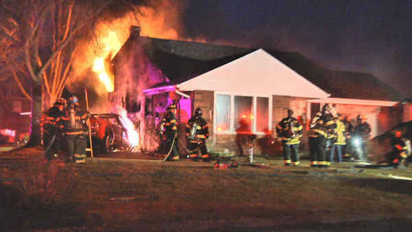 A pickup truck slammed into a Selden, Long Island home causing a huge fire.