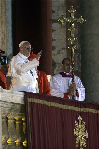 Pope Francis waves to the crowd from the central balcony of St. Peter&#39;s Basilica at the Vatican, Wednesday, March 13, 2013. Cardinal Jorge Bergoglio who chose the name of  Francis, is the 266th pontiff of the Roman Catholic Church. &#40;AP Photo&#47;Luca Bruno&#41; <span class=meta>(AP Photo&#47; Luca Bruno)</span>