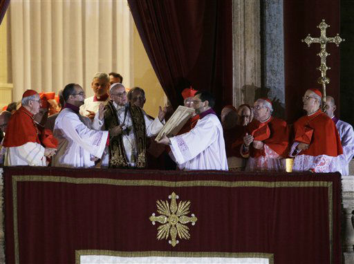 Pope Francis speaks to the crowd from the central balcony of St. Peter&#39;s Basilica at the Vatican, Wednesday, March 13, 2013. Cardinal Jorge Bergoglio, who chose the name of Francis is the 266th pontiff of the Roman Catholic Church.  &#40;AP Photo&#47;Andrew Medichini&#41; <span class=meta>(AP Photo&#47; Andrew Medichini)</span>