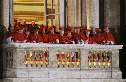 Cardinals watch as Pope Francis speaks to the crowd from the central balcony of St. Peter&#39;s Basilica at the Vatican, Wednesday, March 13, 2013. Cardinal Jorge Bergoglio, who chose the name of Francis is the 266th pontiff of the Roman Catholic Church. &#40;AP Photo&#47;Andrew Medichini&#41; <span class=meta>(AP Photo&#47; Andrew Medichini)</span>