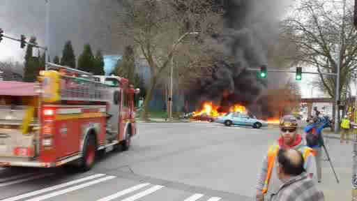 A TV helicopter crashed near the Seattle Space Needle, killing two and injuring one person inside a car.