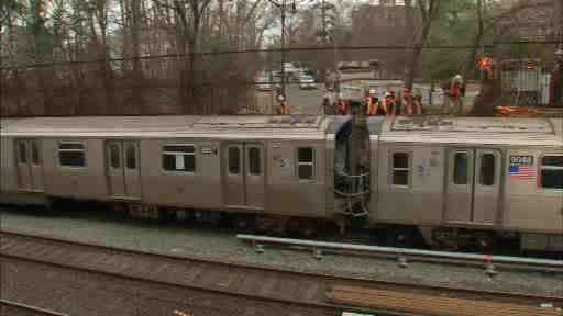 "<div class=""meta ""><span class=""caption-text "">An out-of-control SUV crashed through a fence and ended up on a Q subway train in Brooklyn early Wednesday.</span></div>"