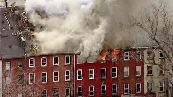 A third alarm fire blazed between a row of homes on Belmont Avenue in Jersey City Wednesday.