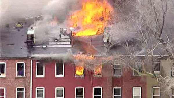 "<div class=""meta ""><span class=""caption-text "">A third alarm fire blazed between a row of homes on Belmont Avenue in Jersey City Wednesday.</span></div>"