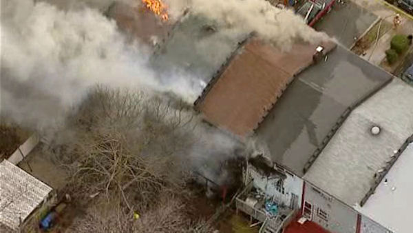 Photos taken from Newscopter 7 over the scene of a fire that appeared to have spread over five homes in Perth Amboy, New Jersey