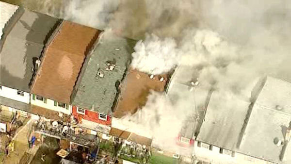 "<div class=""meta ""><span class=""caption-text "">Photos taken from Newscopter 7 over the scene of a fire that appeared to have spread over five homes in Perth Amboy, New Jersey</span></div>"