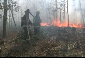 "<div class=""meta ""><span class=""caption-text "">Photos from a brush fire in Manorville, Suffolk County on Tuesday, April 17, 2012.</span></div>"