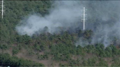 "<div class=""meta image-caption""><div class=""origin-logo origin-image ""><span></span></div><span class=""caption-text"">Photos from a brush fire in Manorville, Suffolk County on Tuesday, April 17, 2012.</span></div>"