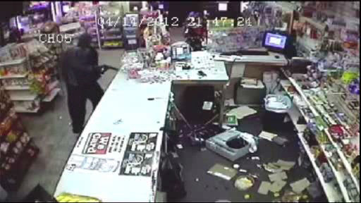 Still frame of surveillance footage of a robbery at 7 Days Deli in Spring Valley, Rockland County on April 15, 2012.