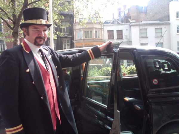 This is the bellhop outside of our hotel, hailing us a black London cab. (Photo by Tara Zimmerman)