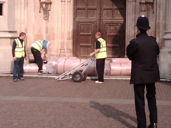 Unloading the red carpet where Kate Middleton will walk down at the Abbey. (Photo by Tara Zimmerman)
