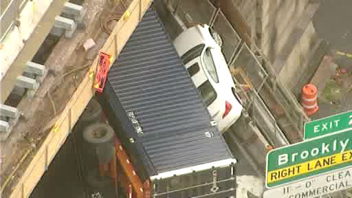 "<div class=""meta ""><span class=""caption-text "">An overturned truck pinned a car against the side of the Brooklyn-Queens Expressway at the Brooklyn Bridge on Monday, April 29, 2013.</span></div>"