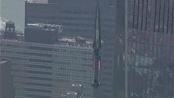 The final pieces of the spire being raised to the roof of One World Trade Center (NewsCopter 7)