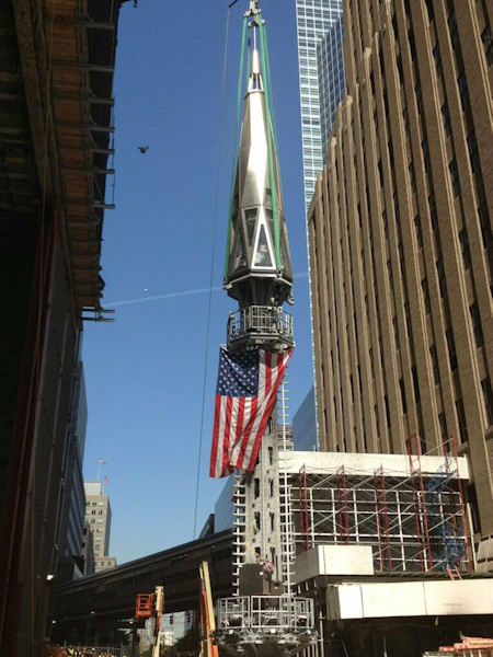 "<div class=""meta image-caption""><div class=""origin-logo origin-image ""><span></span></div><span class=""caption-text"">The final pieces of the spire being raised to the roof of One World Trade Center (Tim Fleischer)</span></div>"