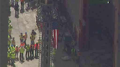 "<div class=""meta image-caption""><div class=""origin-logo origin-image ""><span></span></div><span class=""caption-text"">Photos of the final pieces of the spire being raised to the roof of One World Trade Center.</span></div>"