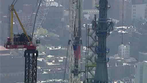 "<div class=""meta ""><span class=""caption-text "">Photos of the final pieces of the spire being raised to the roof of One World Trade Center.</span></div>"