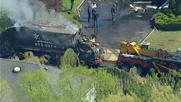 A garbage truck making its normal pickups slammed into a house in East Hanover, New Jersey Tuesday morning.  No one was seriously injured.