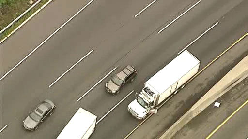 A tire flew off a truck on a highway shattering the front windshield of a tractor trailer on the New Jersey Turnpike in Fort Lee.