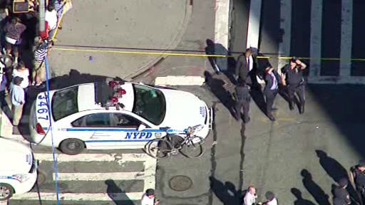 Photos from the scene where a child was killed, her grandmother injured when a car struck them at 97th and Amsterdam Avenue on the Upper West Side on Tuesday morning.