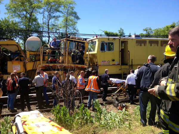 Three people were injured when two Long Island Rail Road work trains collided in Westbury Tuesday morning, causing one to derail.