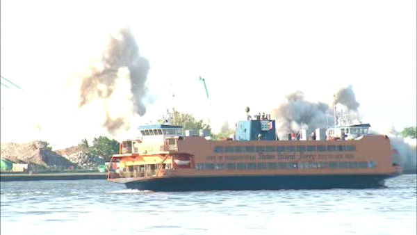 A vacant 11-story building on Governor's Island was imploded Sunday morning to create more recreational space.