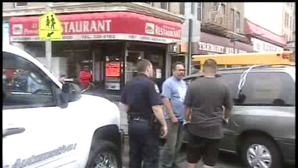 "<div class=""meta ""><span class=""caption-text "">A mini school bus collided with a car and jumped the curb in the East Tremont section of the Bronx.</span></div>"