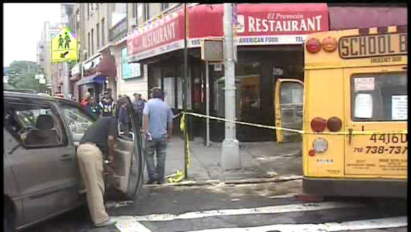 A mini school bus collided with a car and jumped the curb in the East Tremont section of the Bronx.