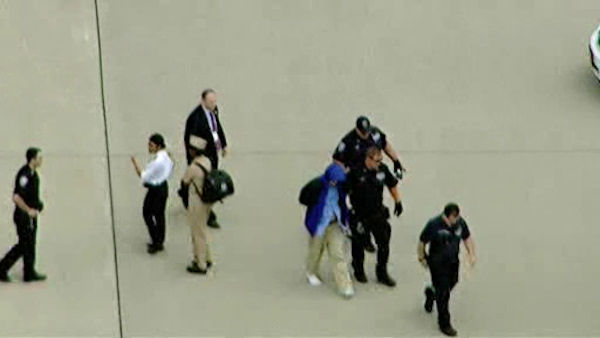 "FBI agents took a suspect into custody from a Hong Kong flight that landed at Newark after reports that a passenger claimed that he had ""poisoned everyone on board."""