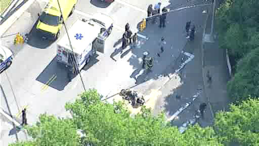 The motorcycle and a car collided on Richmond Terrace, near Snug Harbor Road, on Staten Island seriously injuring an off-duty NYPD officer. (NewsCopter 7)