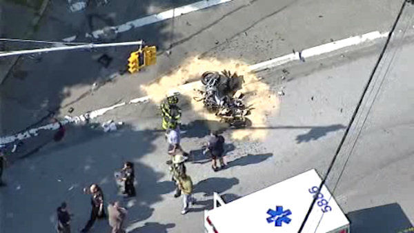 "<div class=""meta ""><span class=""caption-text "">The motorcycle and a car collided on Richmond Terrace, near Snug Harbor Road, on Staten Island seriously injuring an off-duty NYPD officer. (NewsCopter 7)</span></div>"