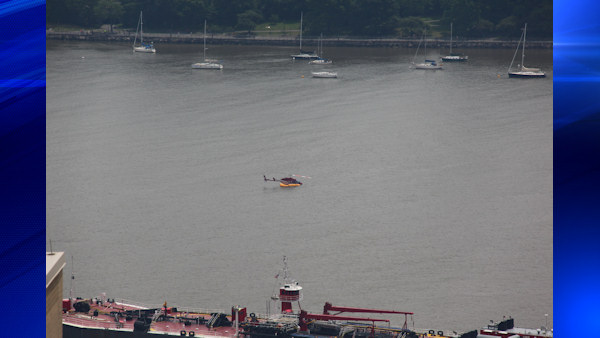 "<div class=""meta image-caption""><div class=""origin-logo origin-image ""><span></span></div><span class=""caption-text"">A pilot and four passengers were rescued and taken to shore after a helicopter made a hard landing in the Hudson River Sunday.</span></div>"