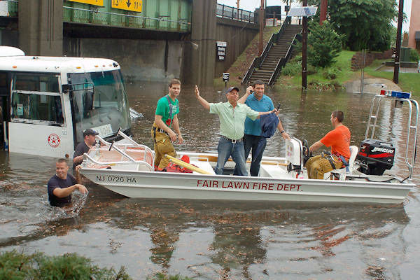 6 people were rescued in Fair Lawn this morning after 2 cars and a commuter bus became stuck in the floodwaters.   CLICK HERE TO READ MORE.    (© 2013 Nick Messina / northjersey.com)