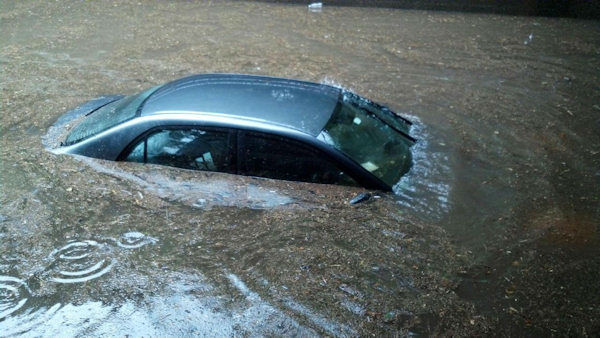 "<div class=""meta ""><span class=""caption-text "">A car trapped in flood waters on Maple Avenue in Glen Rock. (Ernie Mickens)  </span></div>"